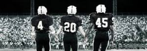 Football players holding hands? Now you're talking!